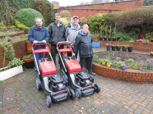 A photo of people with lawnmowers